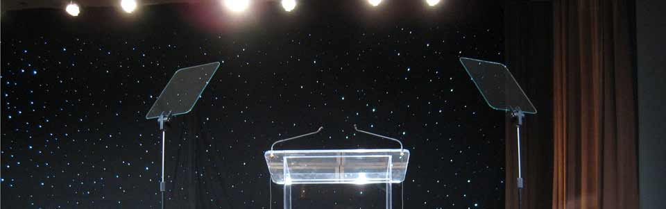 This is a pair of Rise & Fall presidential prompters on the stage during a corporate event.