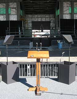 This a presidential prompter on-site at a political rally.  The event was held at an airport using an airplane hanger as shelter for the audience.