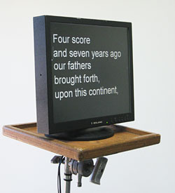 "15"" off-camera prompter monitor on an adjustable stand."